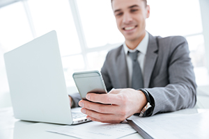 Man smiling at cell phone